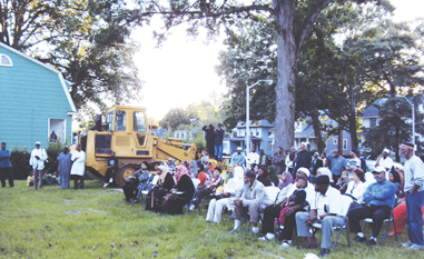 about 100 Muslim and non-Muslim neighbors came out to witness the historic ground breaking. Bulldozers stand ready in the background. Photos by Muslim Link.